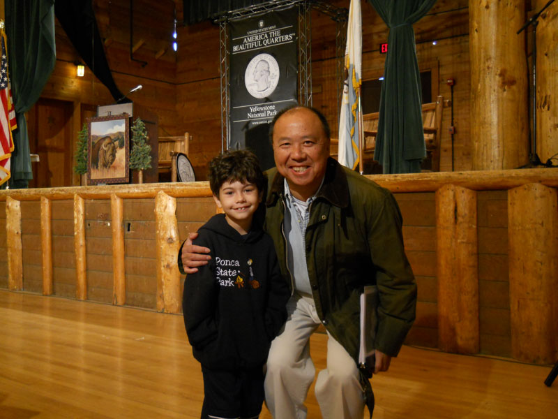 United States Mint Director Edmund Moy and young collector Ian McDermott