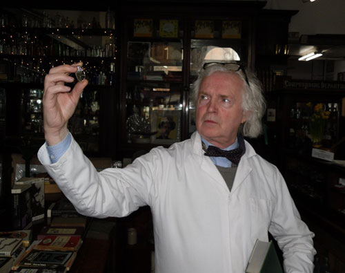 Resident Sweney's Chemist (portrayed by PJ Murphy – O'Brien) inspects the new James Joyce coin