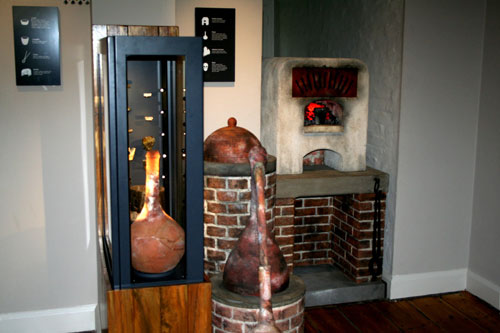 Re-created furnace used to melt down metals. Clay pots from the Tudor era used to melt metals are seen in the enclosure.