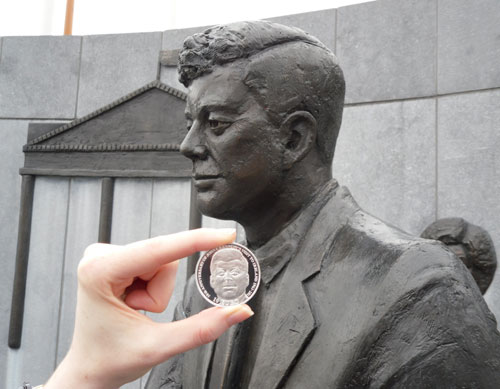 Image from the Central Bank introducing the new silver coin, the background includes the life-size statue of John F Kennedy erected shortly after the President's death.