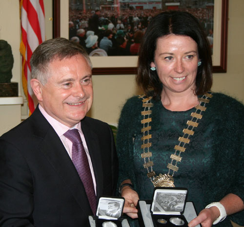 Minister for Public expenditure Brendan Howlin and chairwoman of the New Ross Council Niamh Fitzgibbon are pictured together during the presentation of the coins to the Town Council.