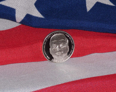 The obverse of the new coin depicting a front-facing President Kennedy and based on a well-known photograph.