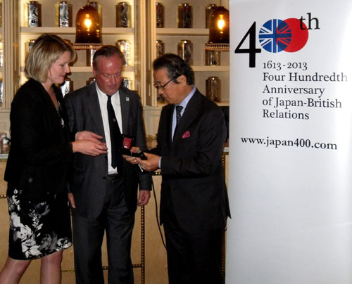 "Senior representative of the Sony Corporation – sponsors of ""Japan 400"" is presented with a commemorative coin"