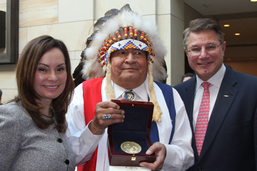 Treasurer Rios and Acting Director Peterson congratulate Wallace Coffee, Chairman of the Comanche Nation (OK).  Coffee accepted the gold medal on                                  behalf of the tribe at the November 20 Code Talker Congressional Gold Medal Ceremony at the U.S. Capitol.