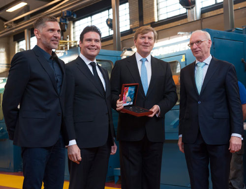From left to right, artist Erwin Olaf, Finance Minister Frans Weekers, King Willem-Alexander and Maarten Brouwer pose with the proof coin set given to the King to mark the day.