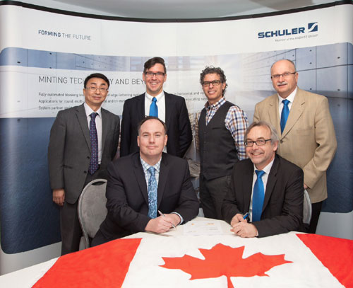 Back row: Dr. Xianyao Li, Chief Technology Officer Royal Canadian Mint (RCM); André Faust, Schuler; Piere Justino, Senior Director R&D RCM; Rudi Schubert, Schuler Inc.; Front row: Sean Byrne, Vice President Operations RCM; Dieter Merkle, General Manager, Schuler (from left).