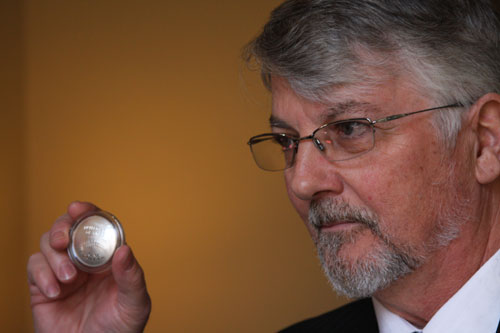 United States Mint Sculptor-Engraver Don Everhart with coin. United States Mint photo by Sharon McPike.
