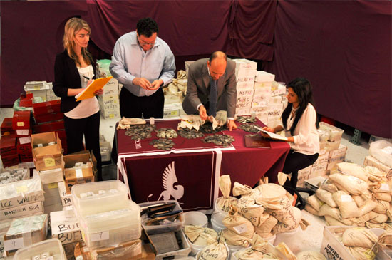 Jenna Kendrella, Scott Reiter, John Pack and Andrea Espindola examine The Stack's West 57th Street Collection.