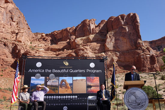 On stage, left to right: Kate Cannon, Arches park superintendent; Dave Sakrison, mayor of Moab and master of ceremonies for the event; Mint Deputy Director Dick Peterson, and at the podium, Spencer J. Cox, lieutenant governor of Utah.