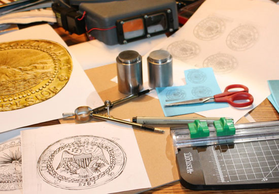 Some of the tools and designs used by engraver Ron Landis to prepare dies for the Brasher Doubloon novodel.  Photo: Ron Landis