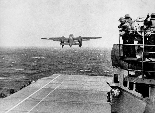 Take off from the deck of the USS HORNET of an Army B-25 on its way to take part in first U.S. air raid on Japan. Doolittle Raid, April 1942.