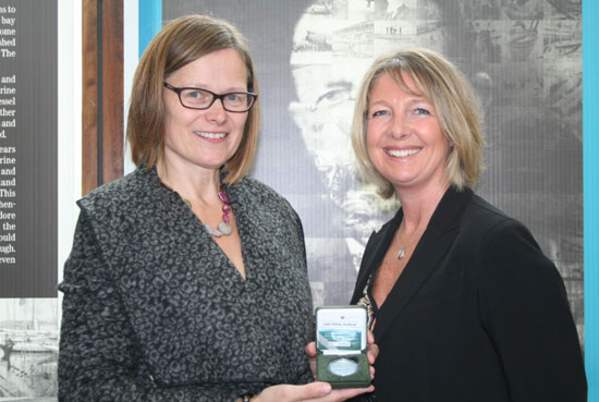 "Mary Gregoriy, designer of the first coin in the ""Irish Science and Inventions"" series and Taya Pobjoy, CEO of the Pobjoy Mint at the official launch of the coin. The Pobjoy Mint produced 10,000 examples of the new coin in proof quality on behalf of the Central Bank of Ireland."