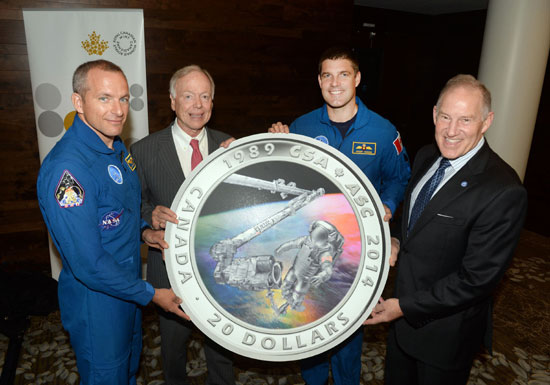 From left to right: Astronaut David Saint Jacques, Royal Canadian Mint Board of Directors member John Bell, astronaut Jeremy Hansen and Canadian Space Agency (CSA) President Walter Natynczyk unveiling the Royal Canadian Mint's new silver collector coin celebrating the 25th anniversary of the CSA at the 2014 International Astronautics Congress in Toronto.