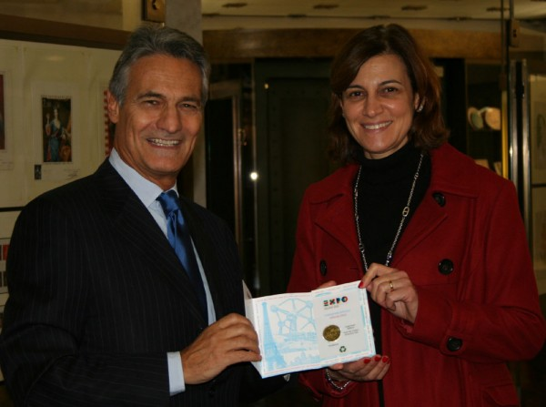 Dr Sandro Sassoli, whose company Museo del Tempo is the exclusive licensee of the EXPO 2015 Milano official souvenir medal presents Magali Vercesi with the latest product during her visit to the EXPO 2015 Milano exhibition at the Musee des Timbres et des Monnaies, Monte Carlo.