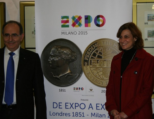 Umberto Moruzzi, curator of the EXPO 2015 Medals collection greets Magali Veresi, Director of the Office of Emissions, Monaco Post at the opening of the EXPO to EXPO  exhibition, Monte Carlo. The Musee des Timbres et des Monnaies is associated with Monaco Post.