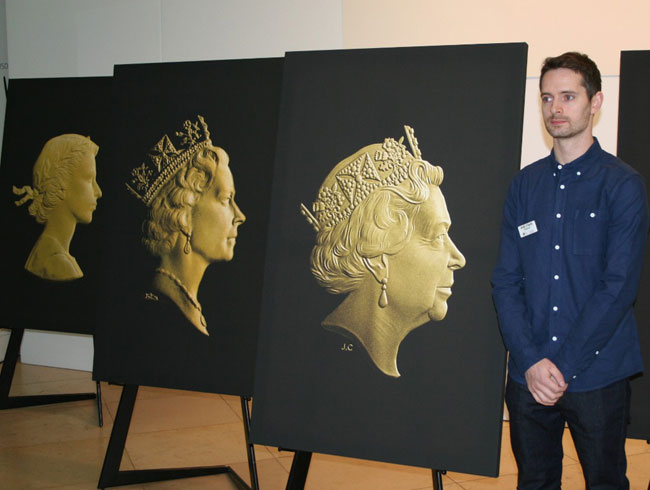 Photos taken during the launch, Jody poses with his and previous effigies of the Queen during the unveiling. Also seen here is the Gillick portrait used from 1953 until 1968 and the Maklouf portrait used from 1985 until 1998.