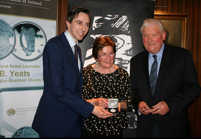 Simon Harris Minister of State along with Caitriona Yeats and Des Geragherty pose after the presentation with the new silver Yeats coin.