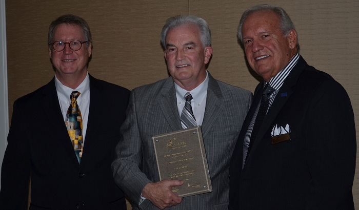 Dana Samuelson, award winner Gary Adkins, Robert Brueggeman Small