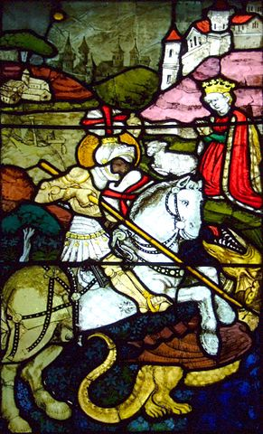 A stained-glass depiction of St. George and the Dragon by Hans Acker, 1440, located in a German church. (Wikipedia photo by Joachim Köhler)