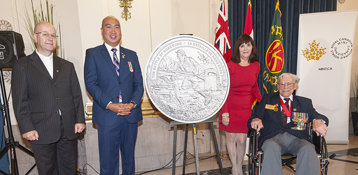 From left: Reverend Paul Lampman, Manitoba MLA Jon Reyes, Royal Canadian Mint board of directors member Bonnie Staples-Lyon, and Second World War veteran and former Winnipeg Grenadier George Peterson.