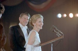 President Reagan and the First Lady speak at the podium at the Inaugural Ball, Shoreham Hotel, Washington D.C. (White House photo)