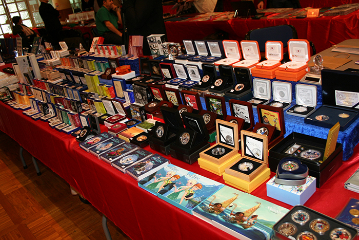 A wide selection of modern collector coins on display.