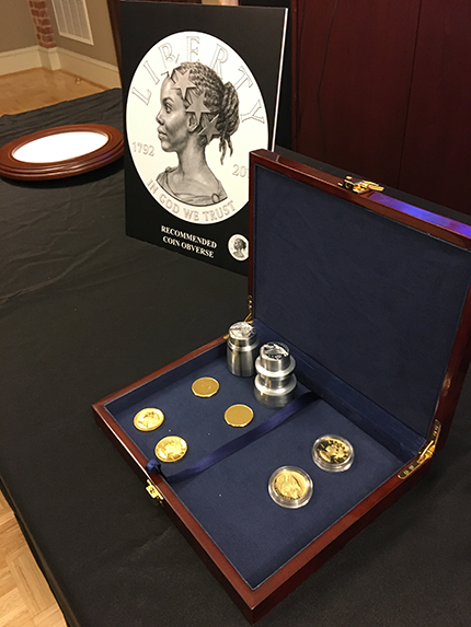 A display of dies, coin blanks, and specimens of the American Liberty 2017 coin.